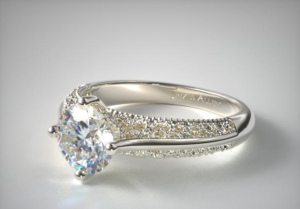 a white gold solitaire with filigree details